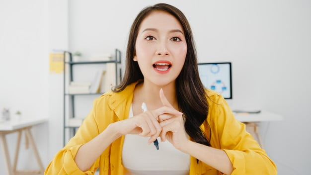 asia businesswoman social distancing new normal situation virus prevention looking camera presentation friends about plan video call while work office lifestyle after corona virus 7861 2596