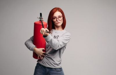 woman with red hair holding fire extinguisher 132075 1978