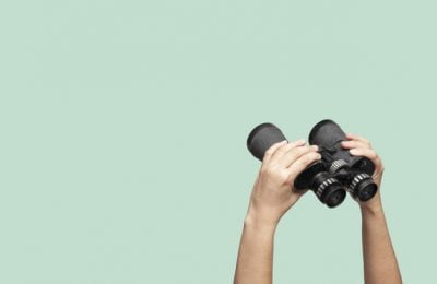 hands holding binoculars green background 42702 112