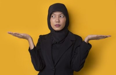 portrait confused asian muslim girl shrugging shoulders 262958 2205