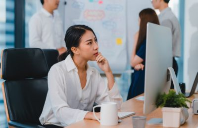 millennial young chinese businesswoman working stress out with project research problem computer desktop meeting room small modern office asia people occupational burnout syndrome concept 7861 2512
