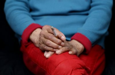 elderly chinese woman sitting smoking women empowerment concept 181624 17278