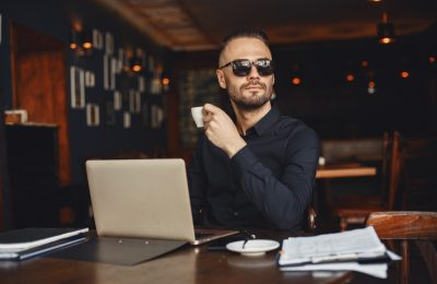man drinks coffe businessman reads documents director shirt