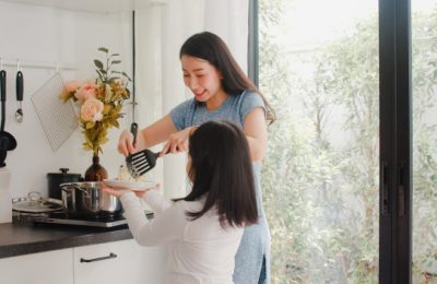 young asian japanese mom daughter cooking home lifestyle women happy making pasta spaghetti together breakfast meal modern kitchen house morning 7861 2224
