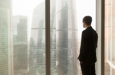 company official looking through window office